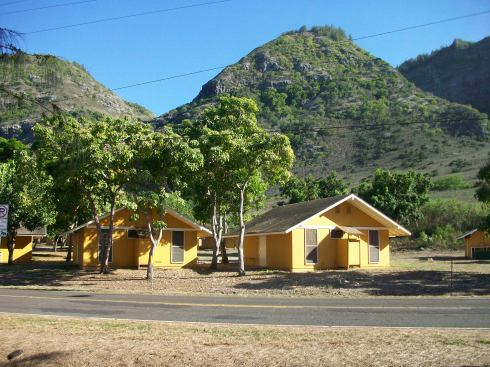 "The yellow cottages of ""New Otherton,"" aka the Dharma Barracks."